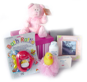 �Baby Hamper consisiting of Oil,soap,shampoo,towel,socks, dress,diapers�