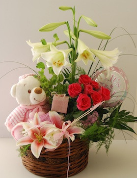 Teddy in Basket of Red and white Flowers