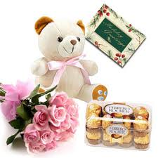 Bunch of Flowers with a half Kg. cake, teddy bear and a box of 16 pcs. Fererro Rocher Chocolates
